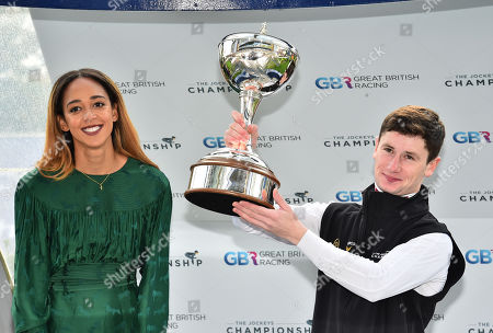 Oisin Murphy, crowned Champion Flat Jockey for 2019, with his trophy which was presented to him by Katerina Johnson-Thompson, World Heptathlon Champion.