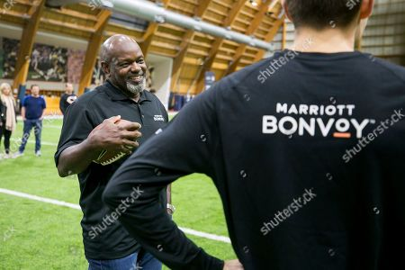Stock Photo of Members of Marriott Bonvoy bid their points to participate in the exclusive moments masterclass led by NFL Hall of Fame running back Emmitt Smith on at Halas Hall in Lake Forest, Ill