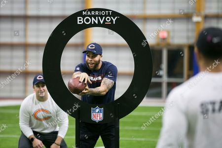 Stock Image of Members of Marriott Bonvoy bid their points to participate in the exclusive moments masterclass led by NFL Hall of Fame running back Emmitt Smith and former Chicago Bear Johnny Knox (center) on at Halas Hall in Lake Forest, Ill