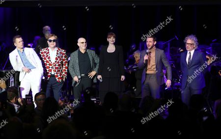 Taron Egerton, Sir Elton John, Bernie Taupin, Bryce Dallas Howard, Jamie Bell, Dexter Fletcher. Taron Egerton, from left, Sir Elton John, Bernie Taupin, Bryce Dallas Howard, Jamie Bell and Dexter Fletcher appear onstage at Paramount Pictures' Rocketman: Live in Concert presented by Black Ink at the Greek Theater on in Los Angeles