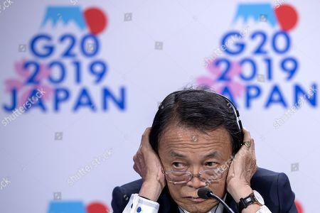 Taro Aso, Japan's Minister of Finance, participates in G20 Presidency news conference during the IMF World Bank Annual Meetings in Washington, DC, USA, 18 October 2019. The meetings continue through 19 October 2019.