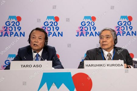 Taro Aso (L), Japan's Minister of Finance, and Haruhiko Kuroda (R), Governor of the Bank of Japan, participate in G20 Presidency news conference during the IMF World Bank Annual Meetings in Washington, DC, USA, 18 October 2019. The meetings continue through 19 October 2019.
