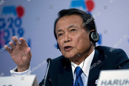 Japan's Finance Minister Taro Aso speaks during a news conference in the sidelines of the World Bank/IMF Annual Meetings in Washington