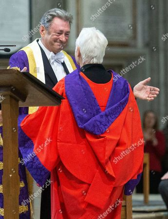 Stock Photo of Judi Dench is joined by the Chancellor of University Alan Titchmarsh as she makes a speech to students at Winchester Cathedral at the end of Ceremony where she received her Honorary Doctorate Degree.