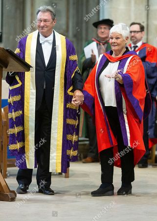 Stock Image of Judi Dench is joined by the Chancellor of University Alan Titchmarsh as she makes a speech to students at Winchester Cathedral at the end of Ceremony where she received her Honorary Doctorate Degree.