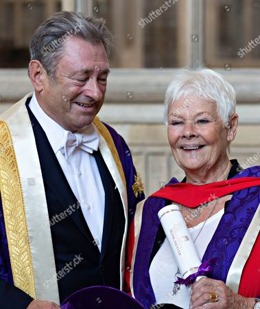 Stock Picture of Judi Dench is joined by the Chancellor of University Alan Titchmarsh as she makes a speech to students at Winchester Cathedral at the end of Ceremony where she received her Honorary Doctorate Degree.