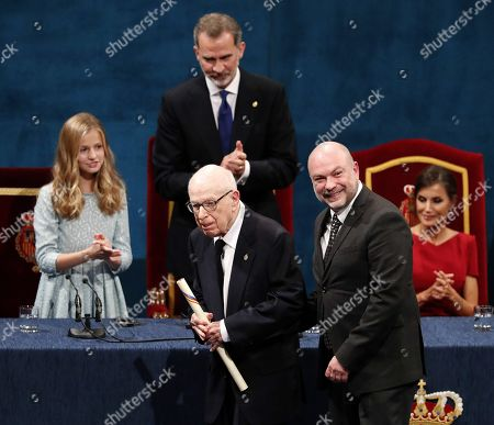 Stock Picture of Spain's Crown Princess Leonor (L) looks on next to her parents, King Felipe VI (C, back) and Queen Letizia (R), after presenting British playwright Peter Brook (C, front) the Princess of Asturias Award of Arts during the 39th Princess of Asturias Awards ceremony at the Campoamor Theater in Oviedo, Asturias, northern Spain, 18 October 2019. The Princess of Asturias Awards are given every year to personalities or organizations from all around the world who make significant achievements in the sciences, arts, literature, humanities and sports.