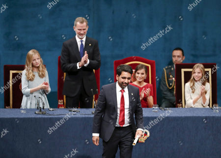 US mathematician Salman Khan (C) reacts after being presented the Princess of Asturias Award of International Cooperation during the 39th Princess of Asturias Awards ceremony at the Campoamor Theater in Oviedo, Asturias, northern Spain, 18 October 2019. The Princess of Asturias Awards are given every year to personalities or organizations from all around the world who make significant achievements in the sciences, arts, literature, humanities and sports.