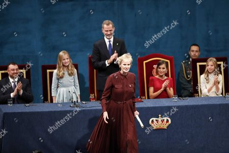 Spain's Crown Princess Leonor (2-L) smiles after presenting US writer Siri Hustvedt (C) the Princess of Asturias 2019 Award for Literature as her father, King Felipe VI (C-R), looks on  during the 39th Princess of Asturias Awards ceremony at the Campoamor Theater in Oviedo, Asturias, northern Spain, 18 October 2019. The Princess of Asturias Awards are given every year to personalities or organizations from all around the world who make significant achievements in the sciences, arts, literature, humanities and sports.