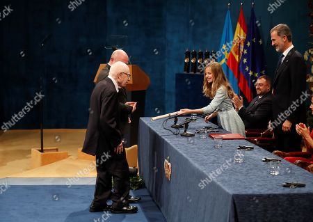 Spain's Crown Princess Leonor (2-L) presents British playwright Peter Brook (L) the Princess of Asturias 2018 Award of Arts as her father, King Felipe VI (R) looks on during the 39th Princess of Asturias Awards ceremony at the Campoamor Theater in Oviedo, Asturias, northern Spain, 19 October 2019. The Princess of Asturias Awards are given every year to personalities or organizations from all around the world who make significant achievements in the sciences, arts, literature, humanities and sports.