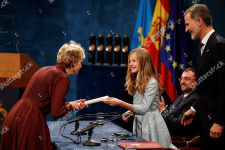 Spain's Crown Princess Leonor (2-L) presents US writer Siri Hustvedt (L) the Princess of Asturias 2019 Award of Literature as her father, King Felipe VI (R), looks on during the 39th Princess of Asturias Awards ceremony at the Campoamor Theater in Oviedo, Asturias, northern Spain, 19 October 2019. The Princess of Asturias Awards are given every year to personalities or organizations from all around the world who make significant achievements in the sciences, arts, literature, humanities and sports.