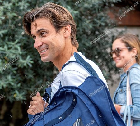 Former Spanish tennis player David Ferrer (L) and wife Marta Tornel arrive at their hotel in Mallorca, Balearic Islands, Spain, 18 October 2019 to attend Spanish tennis player Rafael Nada's wedding. Nadal will marry long-tim partner Maria Francisca Perello 'Xisca' on 19 October on a private ceremony held at the Pollenca Bay in Mallorca. E