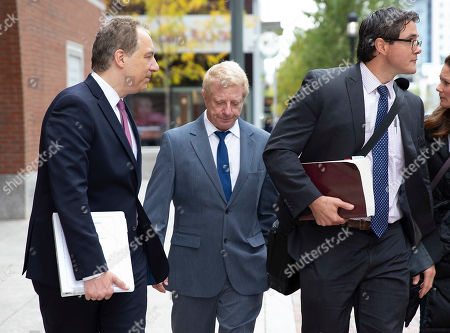 Stock Photo of Developer Robert Flaxman (C) of Laguna Beach California, leaves the Moakley Federal Courthouse with his attorneys, after being sentenced for his role in the College Admissions Scandal, in Boston, Massachusetts, USA 18 October 2019. Flaxman was sentenced to a month in prison, he has to pay a 50,000 US dollars fine and do 250 hours of community service for his involvement in college admission scandal.