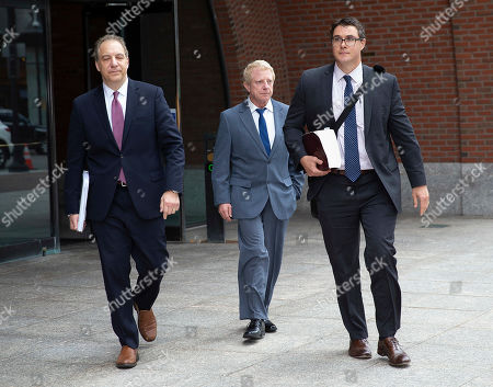 Developer Robert Flaxman (C) of Laguna Beach California, leaves the Moakley Federal Courthouse with his attorneys, after being sentenced for his role in the College Admissions Scandal, in Boston, Massachusetts, USA 18 October 2019. Flaxman was sentenced to a month in prison, he has to pay a 50,000 US dollars fine and do 250 hours of community service for his involvement in college admission scandal.