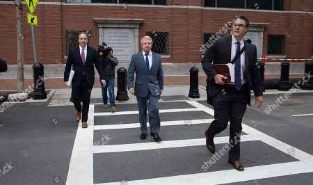 Stock Image of Developer Robert Flaxman (C) of Laguna Beach California, leaves the Moakley Federal Courthouse with his attorneys, after being sentenced for his role in the College Admissions Scandal, in Boston, Massachusetts, USA 18 October 2019. Flaxman was sentenced to a month in prison, he has to pay a 50,000 US dollars fine and do 250 hours of community service for his involvement in college admission scandal.