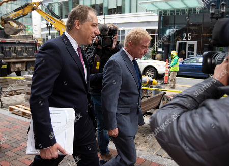 Developer Robert Flaxman (R) of Laguna Beach California, leaves the Moakley Federal Courthouse with his attorneys, after being sentenced for his role in the College Admissions Scandal, in Boston, Massachusetts, USA 18 October 2019. Flaxman was sentenced to a month in prison, he has to pay a 50,000 US dollars fine and do 250 hours of community service for his involvement in college admission scandal.