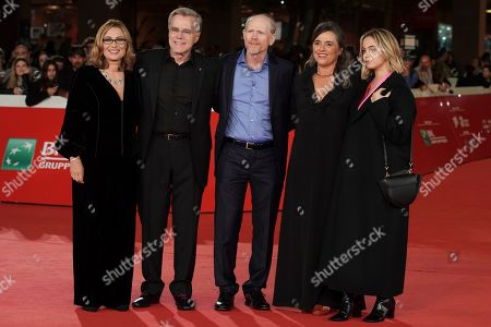 """Director Ron Howard, center, poses with, from left, Pavaarotti's widow Nicoletta Mantovani, producer Nigel Sinclair, Pavarotti's daughter Giuliana Pavarotti, and grandaughter Caterina Lo Sasso on the red carpet of the movie """"Pavarotti"""", at the Rome Film Fest, in Rome"""