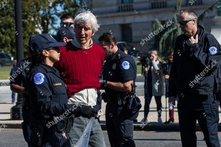 Actor Sam Waterston is arrested by U.S. Capitol Police officers during a rally on Capitol Hill in Washington