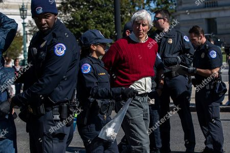 Stock Photo of Actor Sam Waterston is arrested by U.S. Capitol Police officers during a climate protest rally on Capitol Hill in Washington