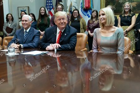 US President Donald J. Trump (C) speaks during a congratulatory call to NASA astronauts Jessica Meir and Christina Koch after they conducted the first all-female spacewalk outside of the International Space Station, from the Roosevelt Room at the White House, Washington, DC, USA, 18 October 2019. With Trump are United States Vice President Mike Pence (L) and Ivanka Trump (R), daughter and advisor to US President Trump.