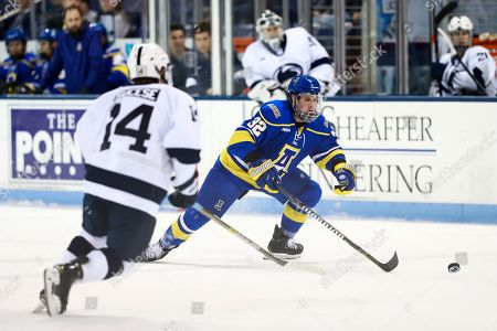 Stock Picture of Alaska Fairbanks defensiveman Tristan Thompson (32) tries to get around Penn State forward Nate Sucese during an NCAA hockey game on in University Park, Pa. The Nittany Lions won 7-0