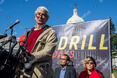 Actor Sam Waterston with Jane Fonda, back right, speaks during a rally on Capitol Hill in Washington, . A half-century after throwing her attention-getting celebrity status into Vietnam War protests, Fonda is now doing the same in a U.S. climate movement where the average age is 18