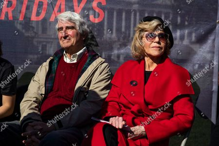 Stock Image of Actor Sam Waterston with Jane Fonda, back right, speaks during a rally on Capitol Hill in Washington, . A half-century after throwing her attention-getting celebrity status into Vietnam War protests, Fonda is now doing the same in a U.S. climate movement where the average age is 18