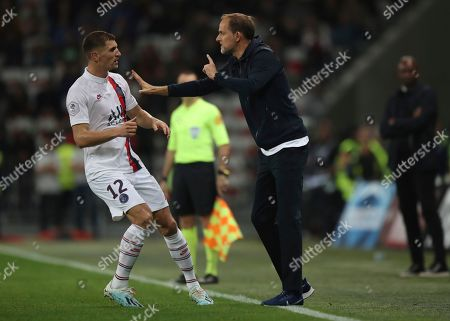Stock Picture of Wesley Sneijder. PSG's head coach Thomas Tuchel speaks to PSG's Thomas Meunier during the French League One soccer match between Nice and Paris Saint Germain in Allianz Riviera stadium in Nice, southern France, Friday, Oct.18, 2019