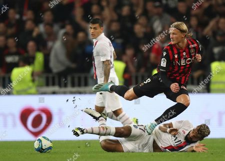 Wesley Sneijder. Nice's Kasper Dolberg vies for the ball with PSG's Eric Maxim Choupo-Moting during the French League One soccer match between Nice and Paris Saint Germain in Allianz Riviera stadium in Nice, southern France, Friday, Oct.18, 2019