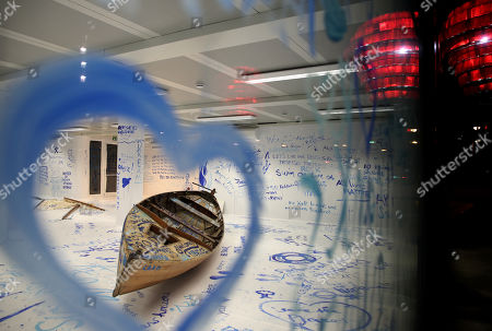 A view of the interactive installation 'Add Color (Refugee Boat)' by Japanese-US artist Yoko Ono, made up of an empty room with a boat where visitors can paint messages and images on the walls, in Dortmund, Germany, 18 October 2019. Performance artist Yoko Ono presented her work at a conference of the Erich Brost Institute for International Journalism at the TU Dortmund where some 90 journalism trainers from 30 European and African countries will discuss reporting on migration and flight.