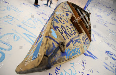 Stock Picture of A view of the interactive installation 'Add Color (Refugee Boat)' by Japanese-US artist Yoko Ono, made up of an empty room with a boat where visitors can paint messages and images on the walls, in Dortmund, Germany, 18 October 2019. Performance artist Yoko Ono presented her work at a conference of the Erich Brost Institute for International Journalism at the TU Dortmund where some 90 journalism trainers from 30 European and African countries will discuss reporting on migration and flight.