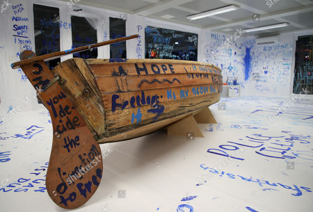 Stock Photo of A view of the interactive installation 'Add Color (Refugee Boat)' by Japanese-US artist Yoko Ono, made up of an empty room with a boat where visitors can paint messages and images on the walls, in Dortmund, Germany, 18 October 2019. Performance artist Yoko Ono presented her work at a conference of the Erich Brost Institute for International Journalism at the TU Dortmund where some 90 journalism trainers from 30 European and African countries will discuss reporting on migration and flight.