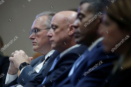 Pacific Gas and Electric Company (PG&E) CEO Bill Johnson, from left, sits with President and CEO Andy Vesey and Senior Vice President, Electric Operations Michael Lewis during a California Public Utilities Commission meeting in San Francisco