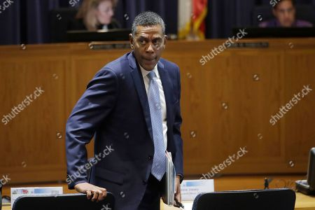 Stock Image of Michael Lewis, Pacific Gas and Electric Company (PG&E) Senior Vice President, Electric Operations walks to his seat after speaking during a California Public Utilities Commission meeting in San Francisco