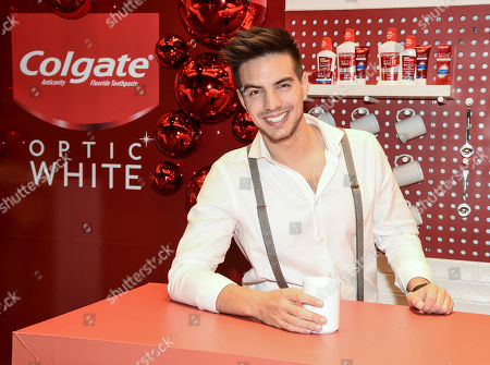 Stock Image of Actor and singer Vadhir Derbez enjoys a cup of coffee while showing off his white smile thanks to Colgate® Optic White® Platinum toothpaste at Hispanicize 2019 on in Los Angeles
