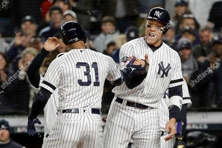 New York Yankees center fielder Aaron Hicks (31) celebrates with Aaron Judge after hitting a three-run home run against the Houston Astros during the first inning of Game 5 of baseball's American League Championship Series, in New York