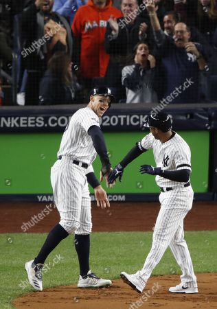 New York Yankees Aaron Hicks (R) is greeted by New York Yankees Aaron Judge (L) after hitting a three-run home run off Houston Astros starting pitcher Justin Verlander during the the first inning of the Major League Baseball American League Championship Series playoff baseball game five at Yankees Stadium in New York, New York, 18 October 2019.