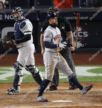 Houston Astros George Springer (C) reacts after striking out against New York Yankees starting pitcher James Paxton as New York Yankees catcher Gary Sanchez (L) looks on during the second inning of the Major League Baseball American League Championship Series playoff baseball game five at Yankees Stadium in New York, New York, 18 October 2019.