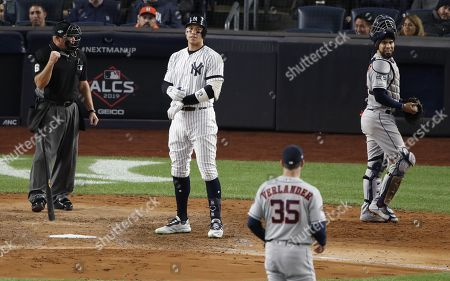New York Yankees Aaron Judge (2-L) stares down Houston Astros starting pitcher Justin Verlander (2-R) after striking out during the fifth inning of the Major League Baseball American League Championship Series playoff baseball game five at Yankees Stadium in New York, New York, 18 October 2019.