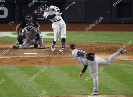 New York Yankees Aaron Judge (C) strikes out swinging against Houston Astros starting pitcher Justin Verlander (R) during the fifth inning of the Major League Baseball American League Championship Series playoff baseball game five at Yankees Stadium in New York, New York, 18 October 2019.