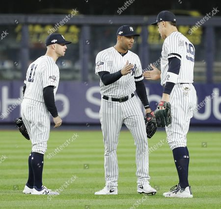 New York Yankees (L-R) Brett Gardnet, Aaron Hicks and Aaron Judge celebrate after the New York Yankees defeated the Houston Astros in their MLB American League Championship Series playoff baseball game five at Yankee Stadium in the Bronx, New York, USA, 18 October 2019. The winner of the seven game playoff series will go on to face the Washington Nationals in the World Series.