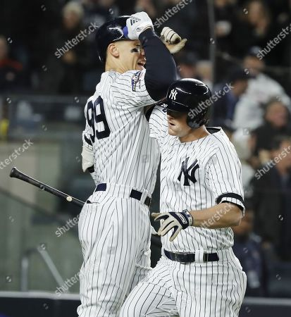 New York Yankees batter DJ LeMahieu (R) celebrates with teammate Aaron Judge (L)after hitting a solo home run off Houston Astros pitcher Justin Verlander in the bottom of the first inning of their MLB American League Championship Series playoff baseball game five at Yankee Stadium in the Bronx, New York, USA, 18 October 2019. The winner of the seven game playoff series will go on to face the Washington Nationals in the World Series.