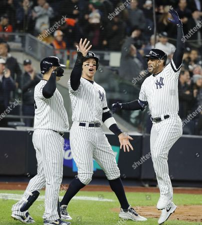 New York Yankees batter Aaron Hicks (R) celebrates with teammates Aaron Judge (C) and Gary Sanchez (L) after hitting a three-run home run in the bottom of the first inning of their MLB American League Championship Series playoff baseball game five at Yankee Stadium in the Bronx, New York, USA, 18 October 2019. The winner of the seven game playoff series will go on to face the Washington Nationals in the World Series.