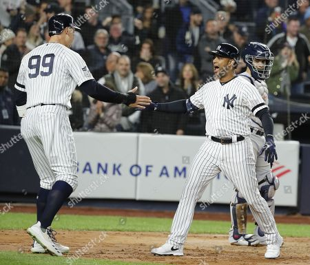 New York Yankees batter Aaron Hicks (R) celebrates with teammate Aaron Judge (L) after hitting a three-run home run in the bottom of the first inning of their MLB American League Championship Series playoff baseball game five at Yankee Stadium in the Bronx, New York, USA, 18 October 2019. The winner of the seven game playoff series will go on to face the Washington Nationals in the World Series.