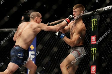 Stock Image of Joe Lauzon, Jonathan Pearce. Joe Lauzon, left, punches Jonathan Pearce during a lightweight mixed martial arts bout, at UFC Fight Night in Boston