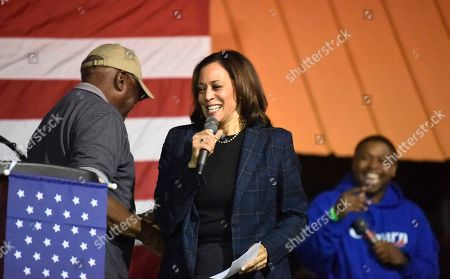Stock Picture of Democratic presidential contender Kamala Harris takes the stage at a candidate cookoff after being introduced by House Majority Whip Jim Clyburn, left, in Orangeburg, S.C