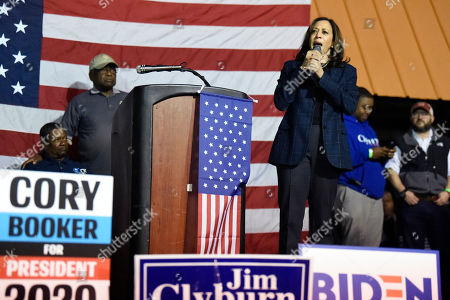 Stock Image of Democratic presidential contender Kamala Harris takes the stage at a candidate cookoff after being introduced by House Majority Whip Jim Clyburn, in Orangeburg, S.C