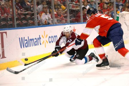 Gabriel Landeskog, Aaron Ekblad. Colorado Avalanche left wing Gabriel Landeskog (92) and Florida Panthers defenseman Aaron Ekblad (5) vie for the puck during the first period of an NHL hockey game in Sunrise, Fla