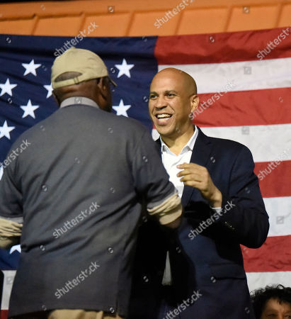 Stock Photo of Democratic presidential hopeful Cory Booker is introduced by House Majority Whip Jim Clyburn, left, at a candidate cookoff, in Orangeburg, S.C