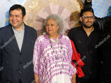 Mexican author Laura Esquivel, center, poses for a photo on the red carpet as she arrives for the opening ceremony of the Morelia Film Festival in Morelia, Mexico